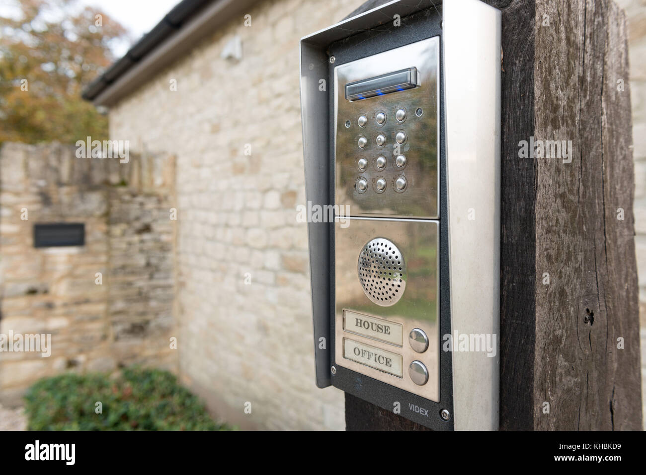 An entry code keypad controlling the entrance to a gated home and office - Stock Image