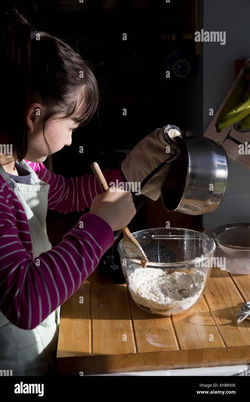Girl baking at home - Stock Image