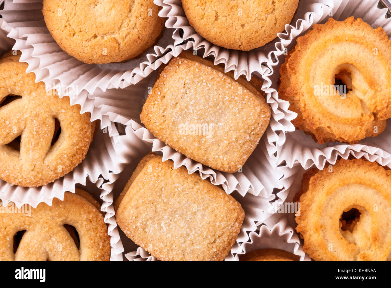 An overhead photo of Danish butter cookies in their paper skirts, a closeup of the traditional Christmas pastry - Stock Image