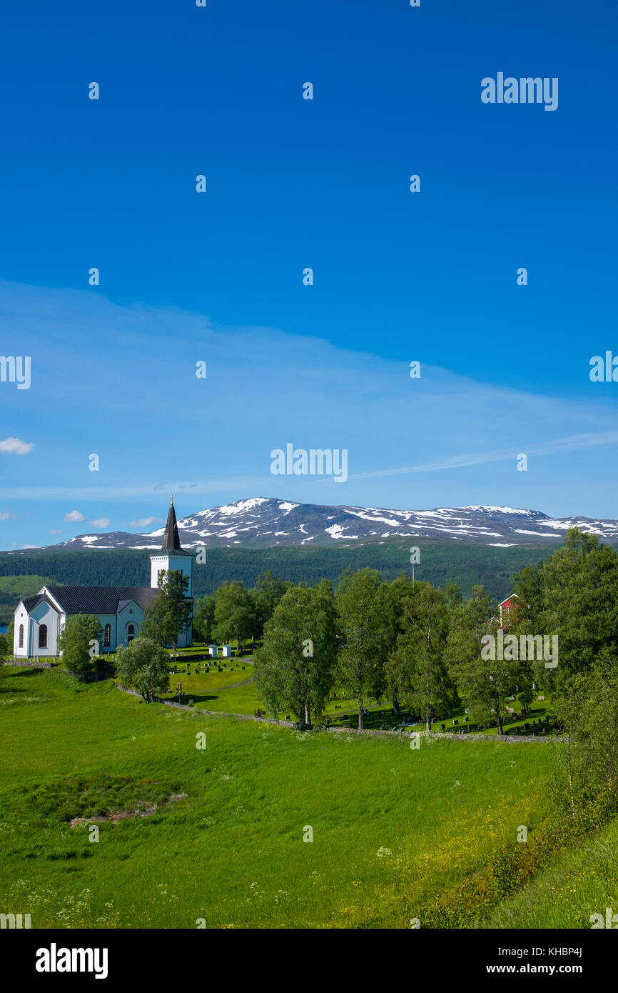 Picturesque Church in the swedish north, between the mountans and a lonely road - Stock Image