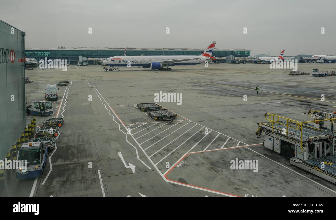 Heathrow, Terminal 5, London, UK - September 25, 2017:  British Airways plane taxying to apron.  Early morning shot - Stock Image