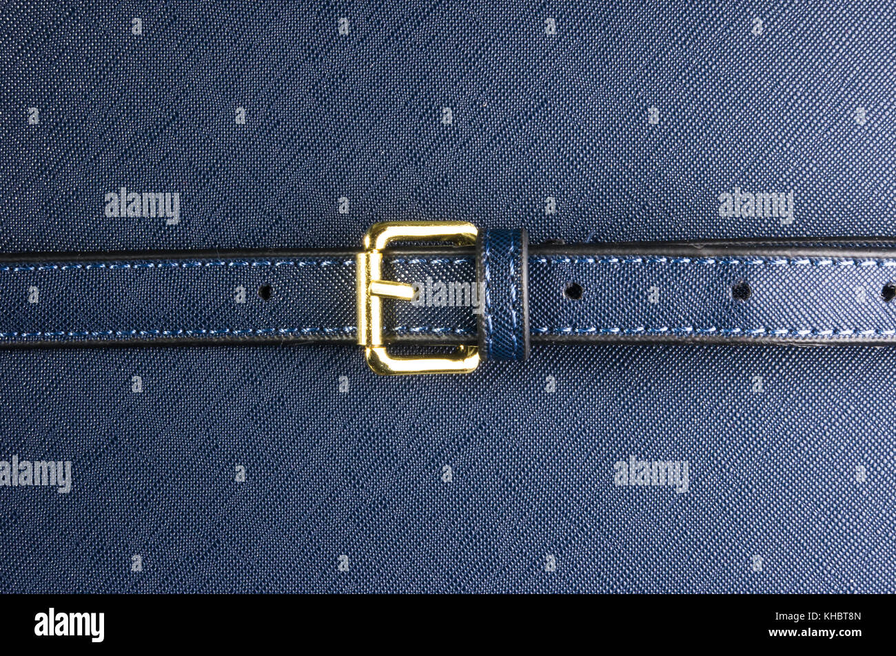 closeup of buckles, clasps, zippers, pockets, fasteners, fittings and seams on the blue hand bag Stock Photo