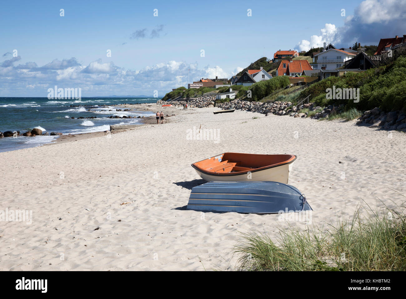 Boats on white sand beach and town behind, Tisvilde, Kattegat Coast, Zealand, Denmark, Europe - Stock Image