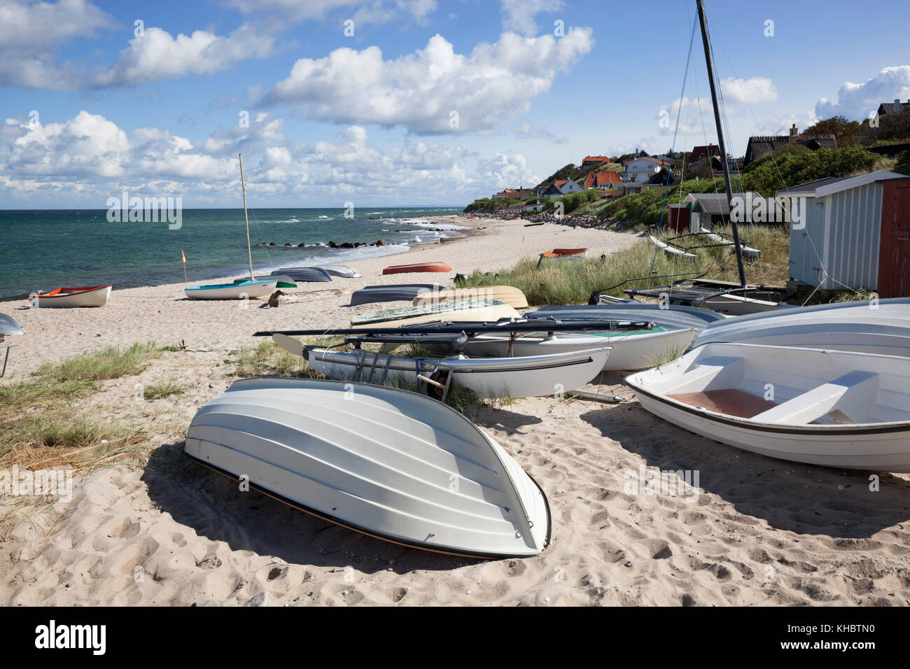 Boats on white sand beach and town behind, Tisvilde, Kattegat Coast, Zealand, Denmark, Europe - Stock Image