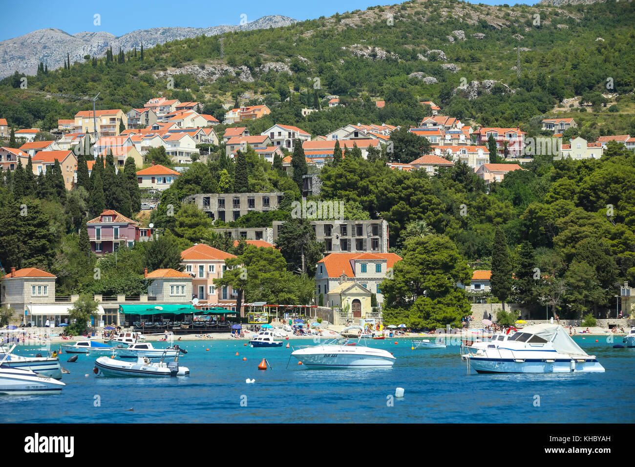SREBRENO, CROATIA - JULY 18, 2017 : A view of boats anchored at seaside in Dubrovnik riviera in Srebreno, Croatia. - Stock Image