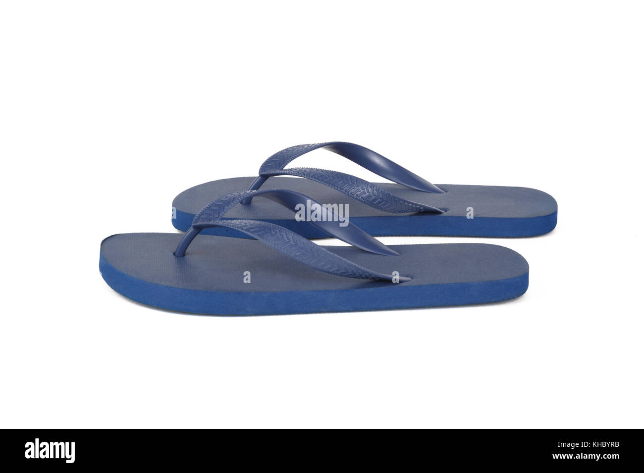 c99b20a8e41 Close up detailed front view of dark blue plastic flip flops slippers  isolated on white background