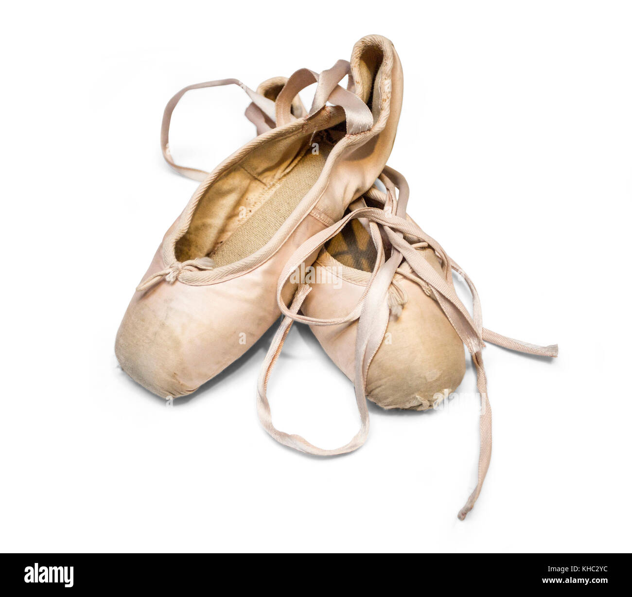 Old used ballet shoes isolated on white background. with clipping path - Stock Image