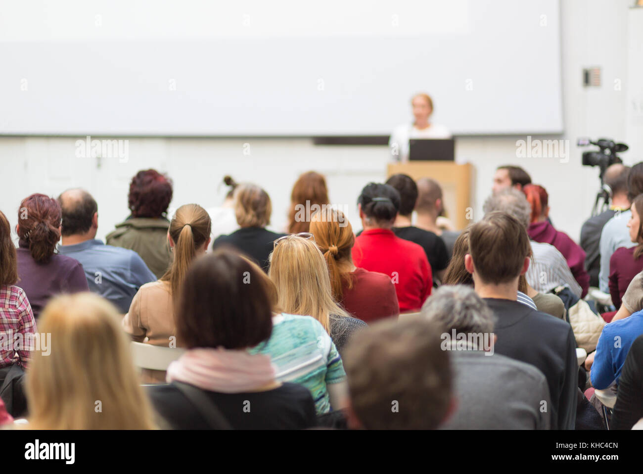 Woman giving presentation on business conference. - Stock Image