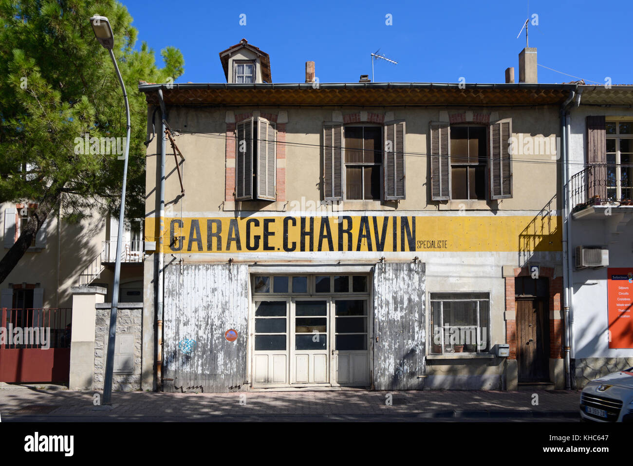 Abandoned, Vacant or Closed Automobile Repair Shop, Workshop, Local Garage, or Small Business, Vaison-la-Romaine, - Stock Image
