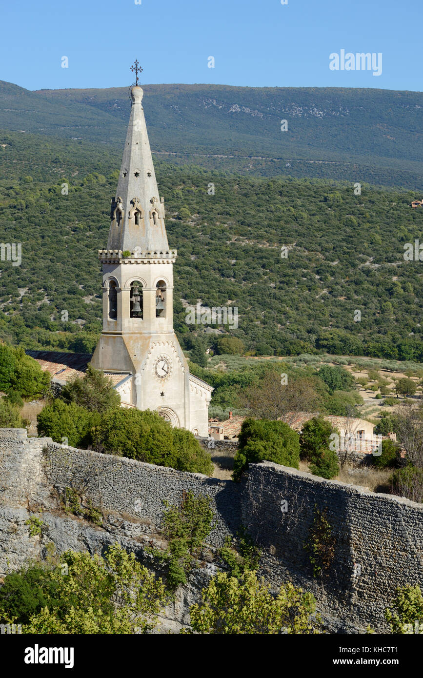 Church Spire & Castle Walls or Remains of Ruined Château at Saint Saturnin-les-Apt, Vaucluse, Luberon, - Stock Image