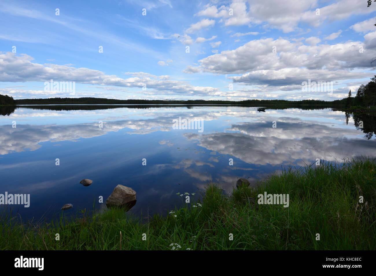 Lake, Örklingen, clouds, forest, reflections, Johannisholm, Mora kommun, Dalarna county, Sweden *** Local Caption - Stock Image