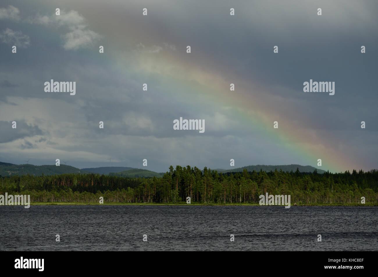 Lake, Örklingen, thunderstorm, rainbow, forest, hills, Johannisholm, Mora kommun, Dalarna county, Sweden *** - Stock Image