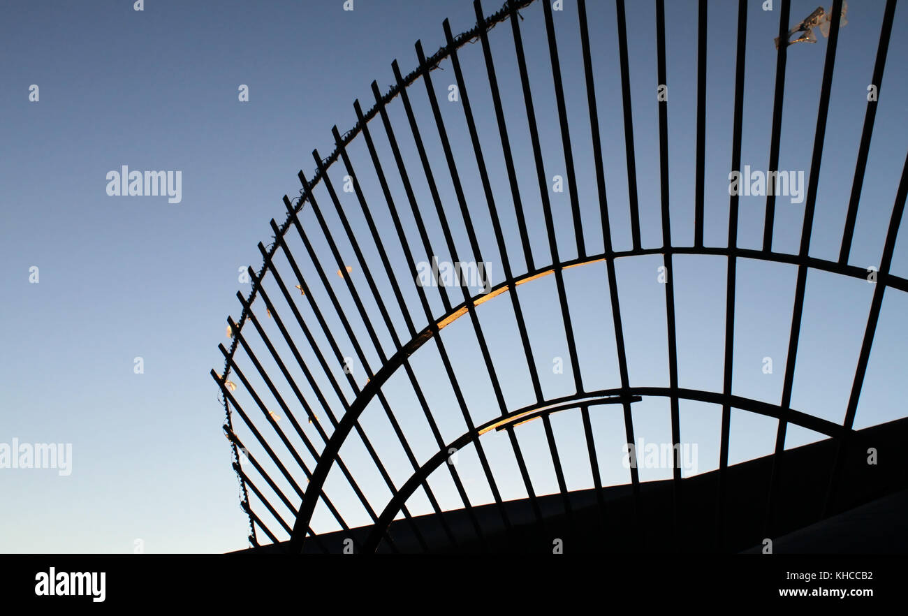 Detail of border gate in the evening - Stock Image