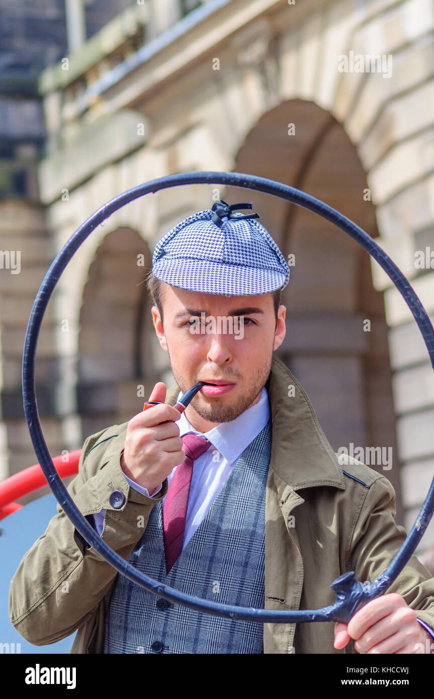 Male performer dressed as fictional character, private detective, Sherlock Holmes on the Royal Mile during the Edinburgh Stock Photo