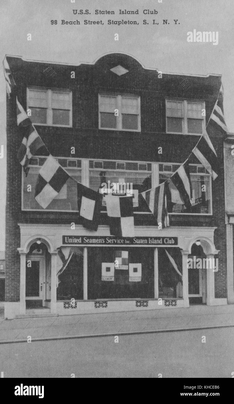 A postcard from a photograph of a local branch of the United Seamen's Service, the three story brick fronted building Stock Photo