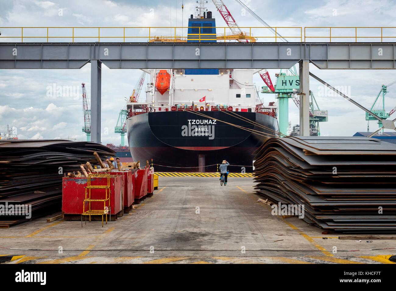 Shipbuilding steel plates in dockyard. Camranh shipyard. Vietnam Stock Photo