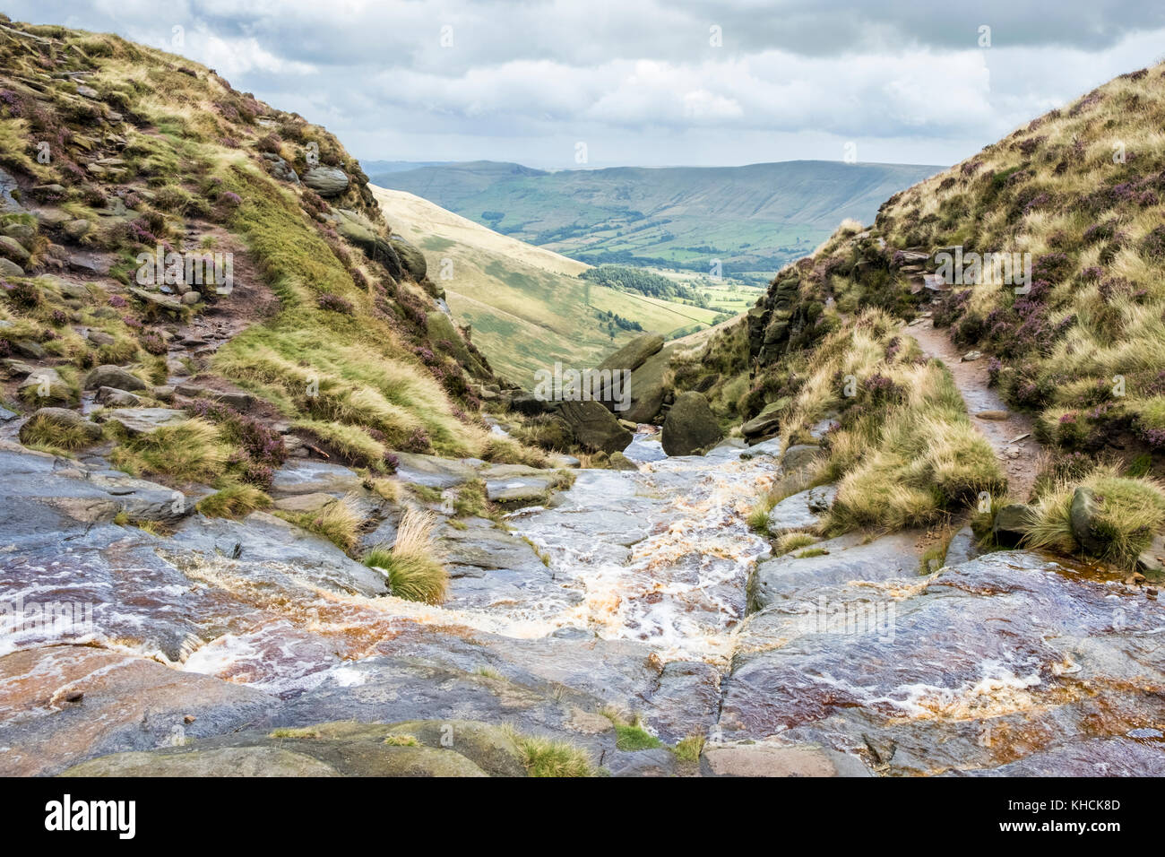 View high above the Vale of Edale countryside with Crowden Brook stream flowing down Crowden Clough, Kinder Scout, - Stock Image