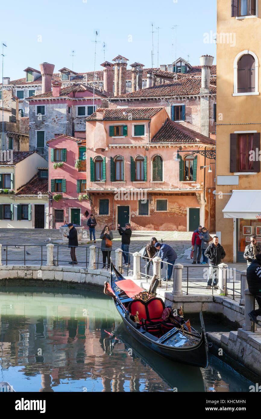 Campo della maddelena and gondola, Cannaregio, Venice, Italy with colourful medieval houses and Venetian chimney - Stock Image
