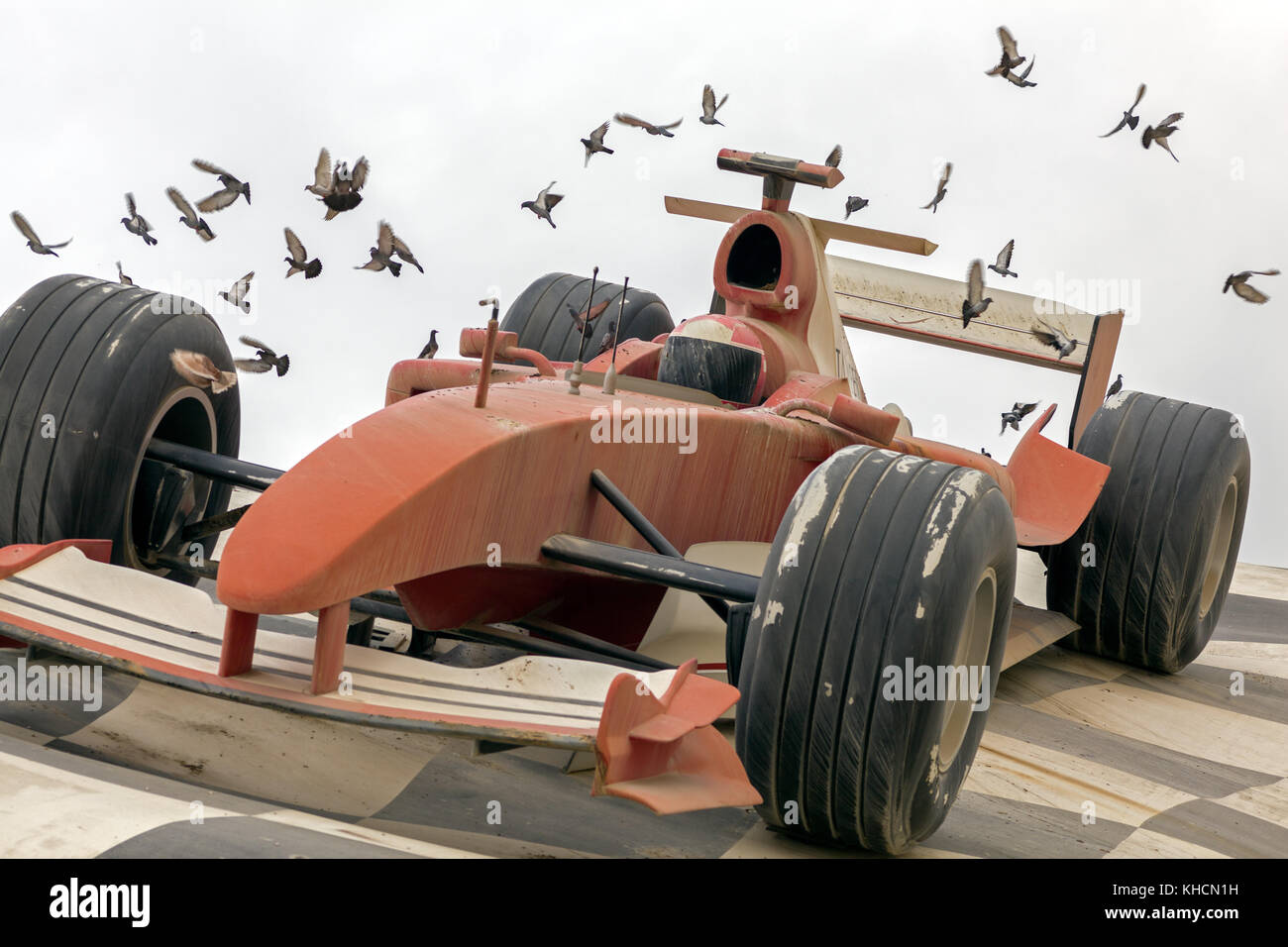 Decayed reconstruction of a formular racing car as an attraction of amusement park Dubailand - Stock Image