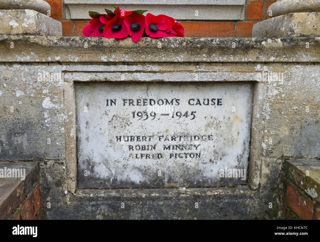 Stone memorial, inscribed In Freedom's Cause, to three men who fell in WW2 in the village of Yardley Hastings, - Stock Image