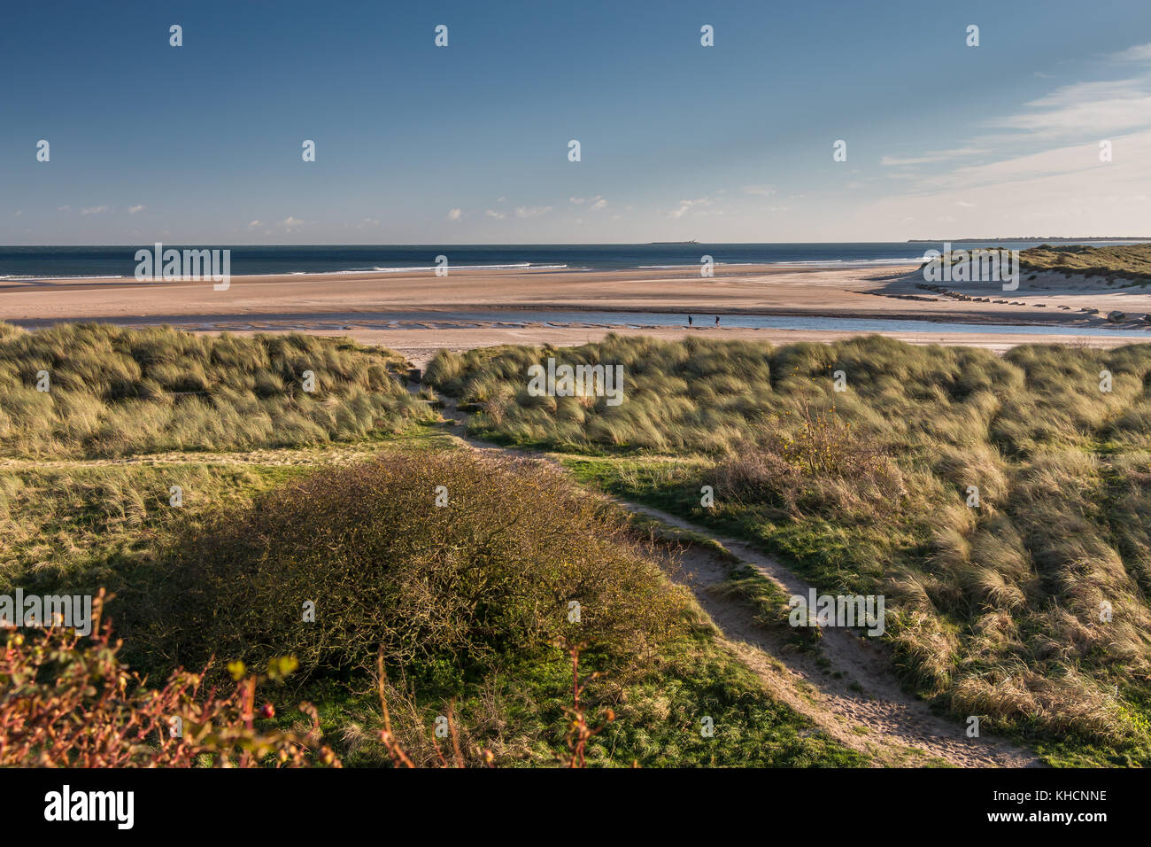 The Aln Estuary and Beach, with Coquet Island on the horizon. Alnmouth Northumberland, UK on a fine autumn day, - Stock Image
