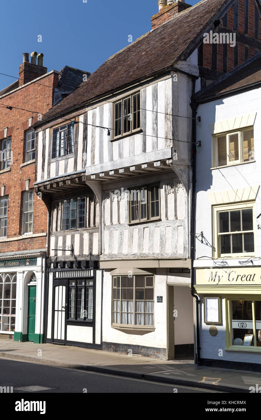 UK, Tewkesbury, shops and old Tudor buildings along the high street. - Stock Image