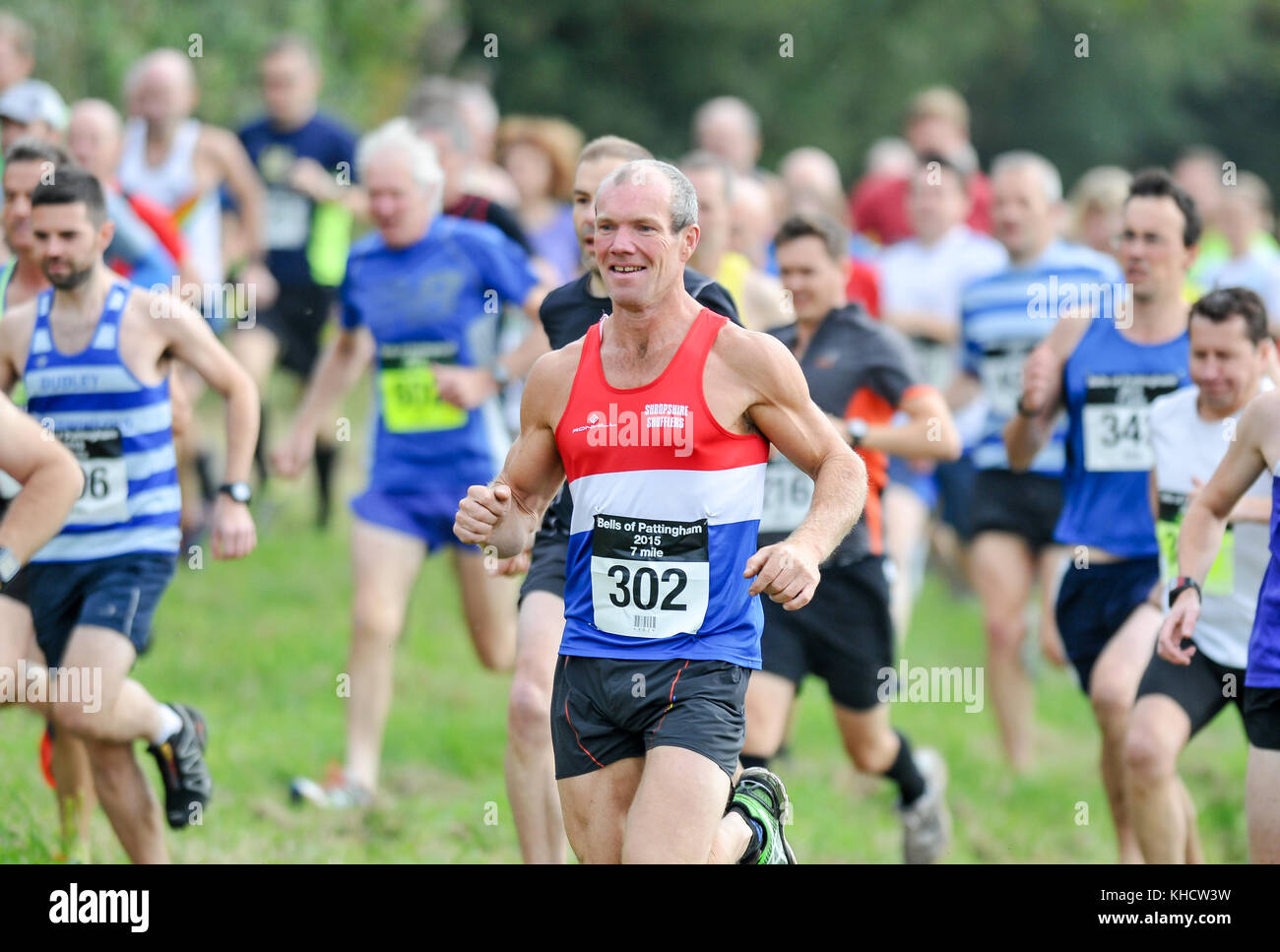Male cross country runner after leaving the start line of a race in Staffordshire, England, UK - Stock Image