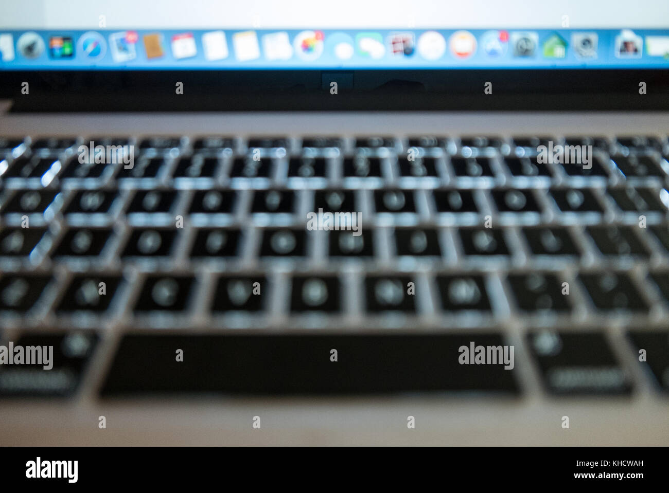 mac pro laptop keyboard and screen shot slightly out of