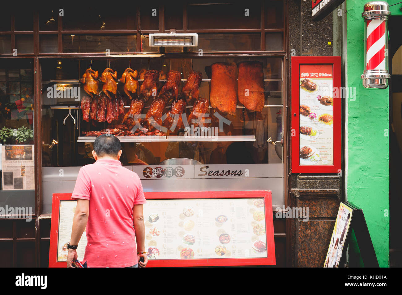 Crispy ducks hanging in a Chinese restaurant window in Chinatown. London, 2017. Landscape format. - Stock Image