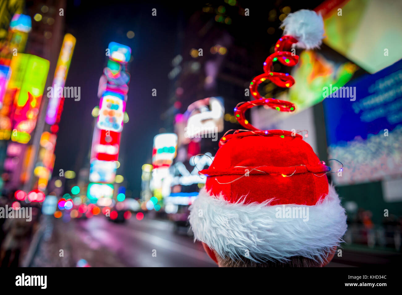 Santa hat with colorful Christmas lights in Times Square, New York City - Stock Image