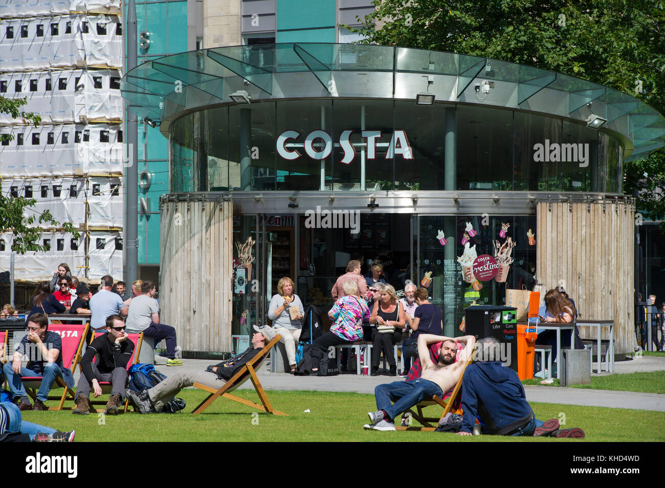 Customers Relax In Deck Chairs Outside The Costa Coffee Shop