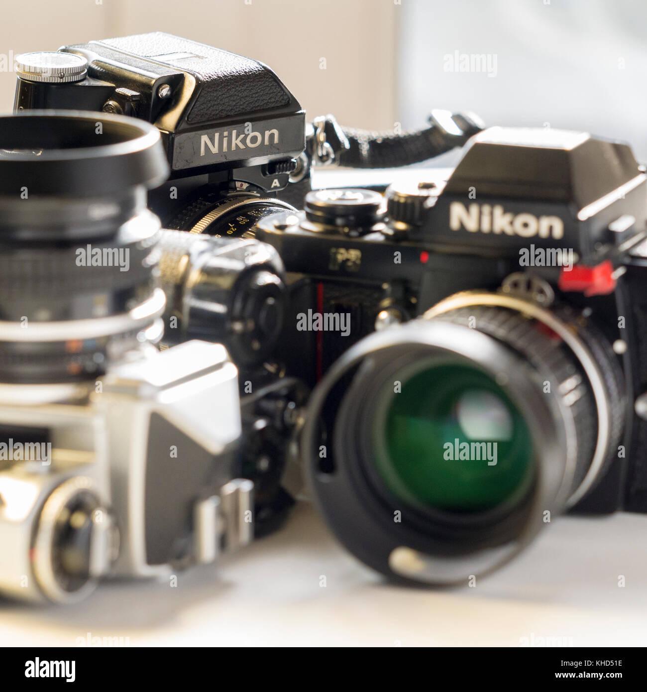 Nikon FE, Nikon FE and Nikon F3 single lens reflex 35mm professional film camera's, Nikon is Japanese company and Stock Photo
