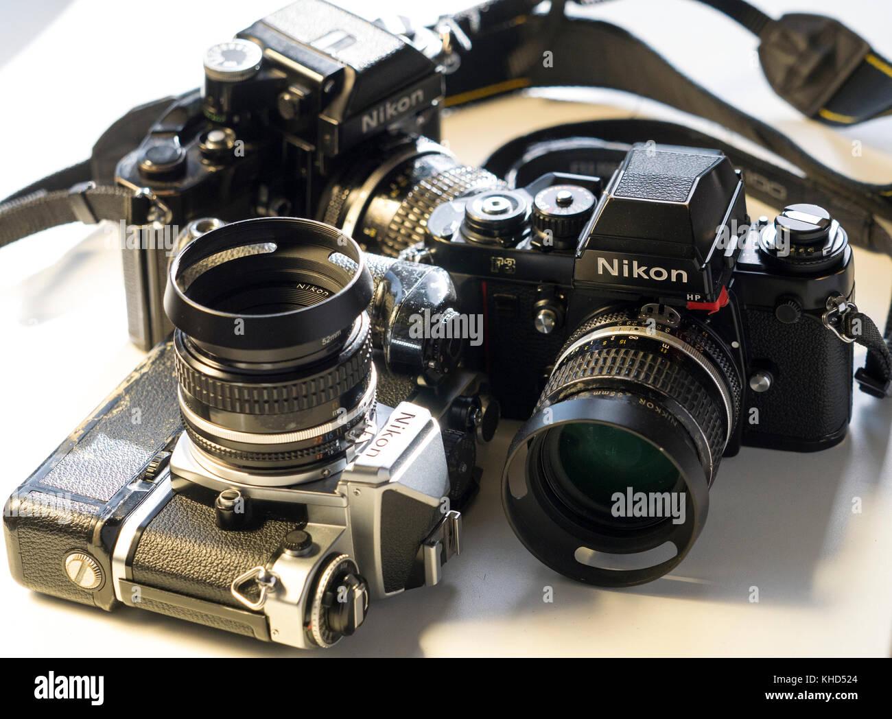Nikon FE, Nikon FE and Nikon F3 single lens reflex 35mm professional film camera's, Nikon is Japanese company - Stock Image