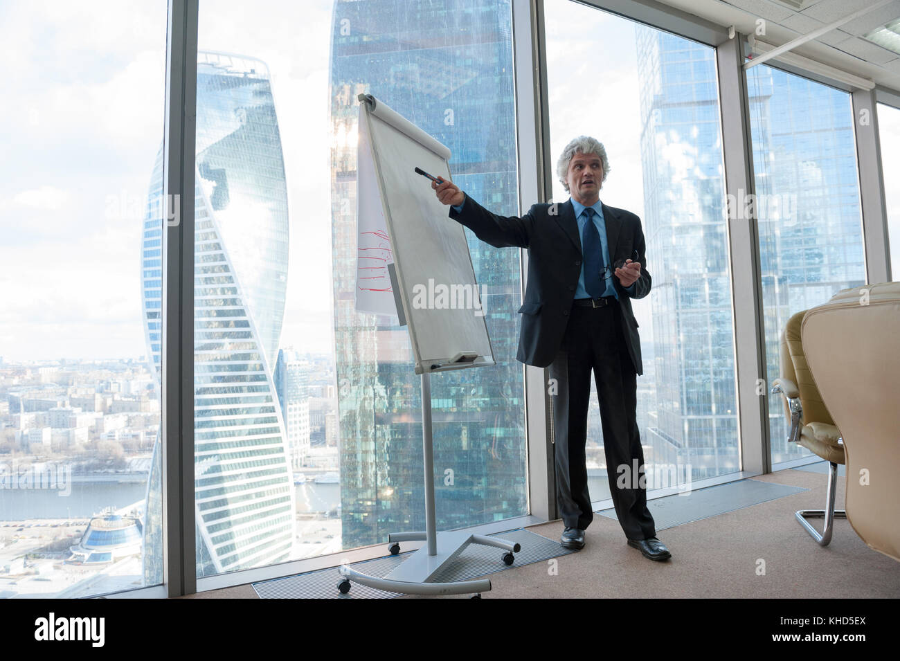 Mature business man making a presentation - Stock Image
