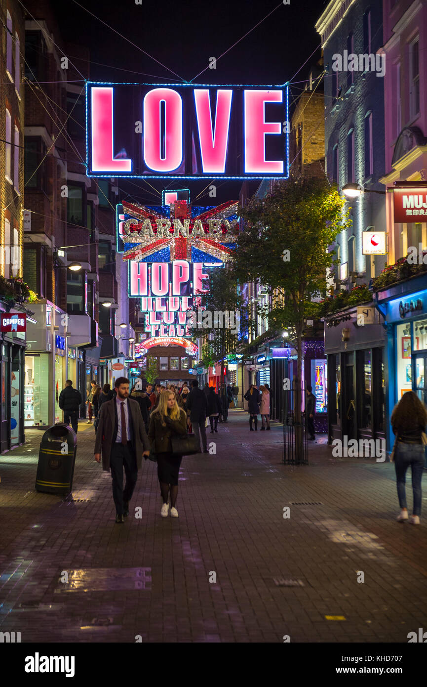 LONDON - NOVEMBER 16, 2016: Christmas holiday signs of love, hope, and affection decorate the shopping center of - Stock Image