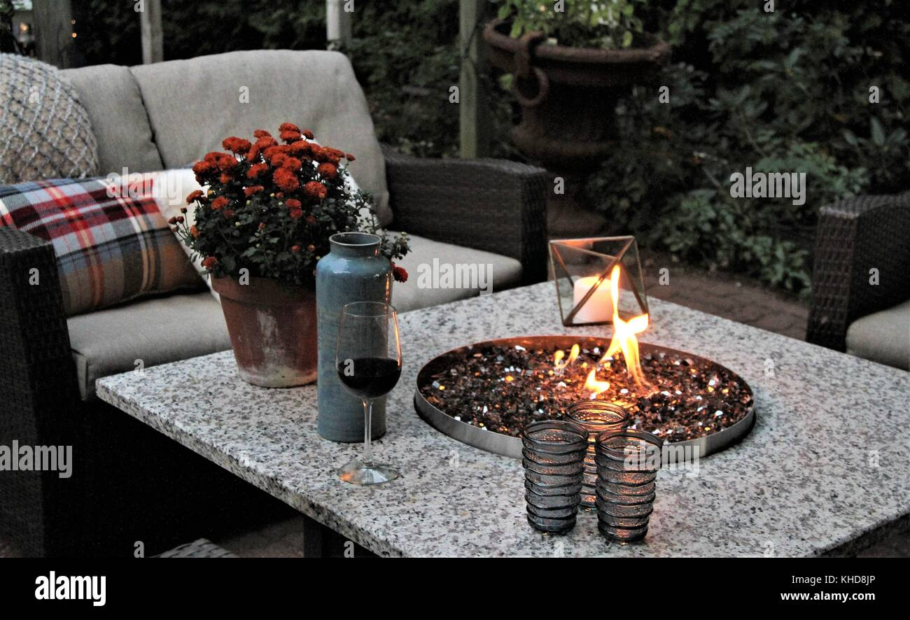 Outdoor Seating Arrangement Around A Gas Fire Pit Table In The Fall Stock Photo Alamy
