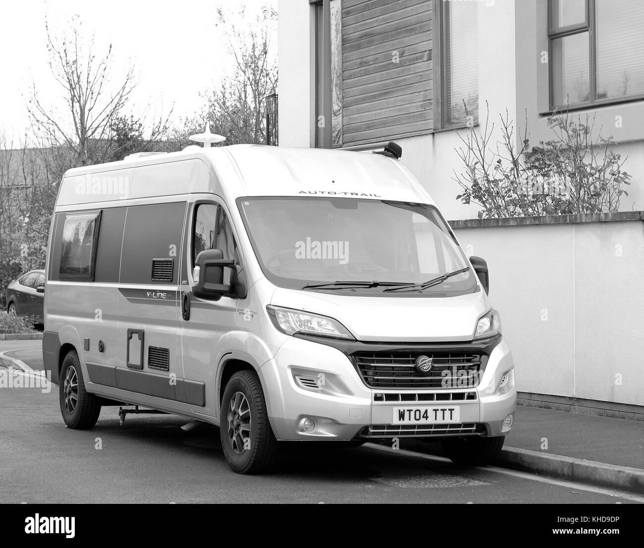 November 2017 - Camper van parked in a residential street, as the owner has no off street parking avilable in a - Stock Image
