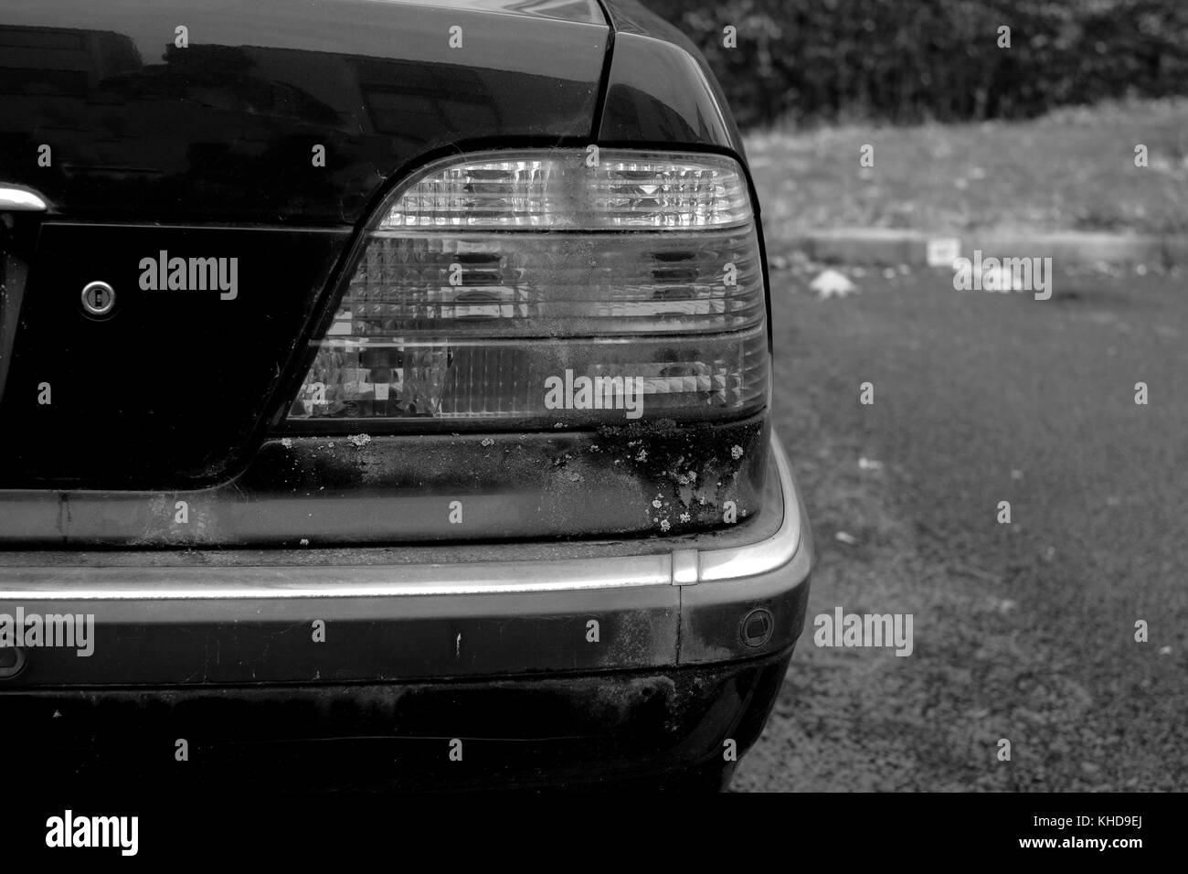 November  - Rear lights of an old BMW saloon 728i - Stock Image