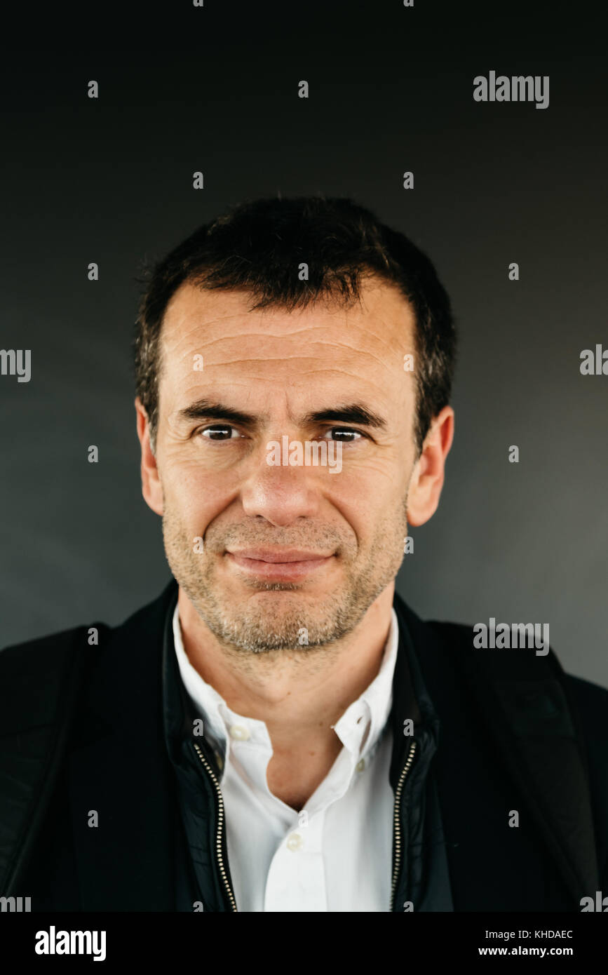Portrait of middle-aged unshaved man smiling - Stock Image