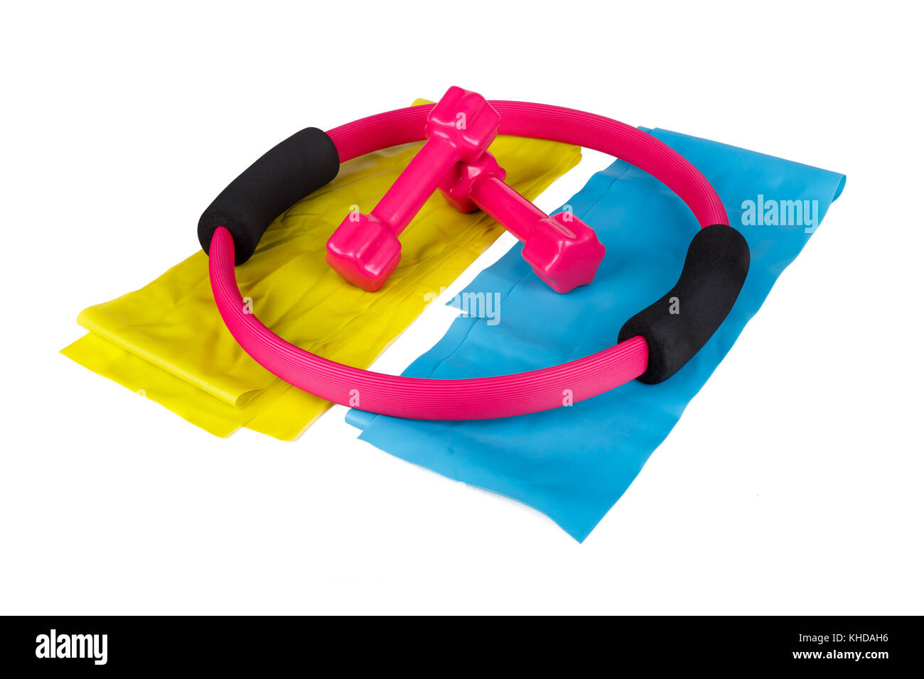 Pink dumbbells and rubber band, pilates circle healthy life and sport concept, isolated on white background. - Stock Image