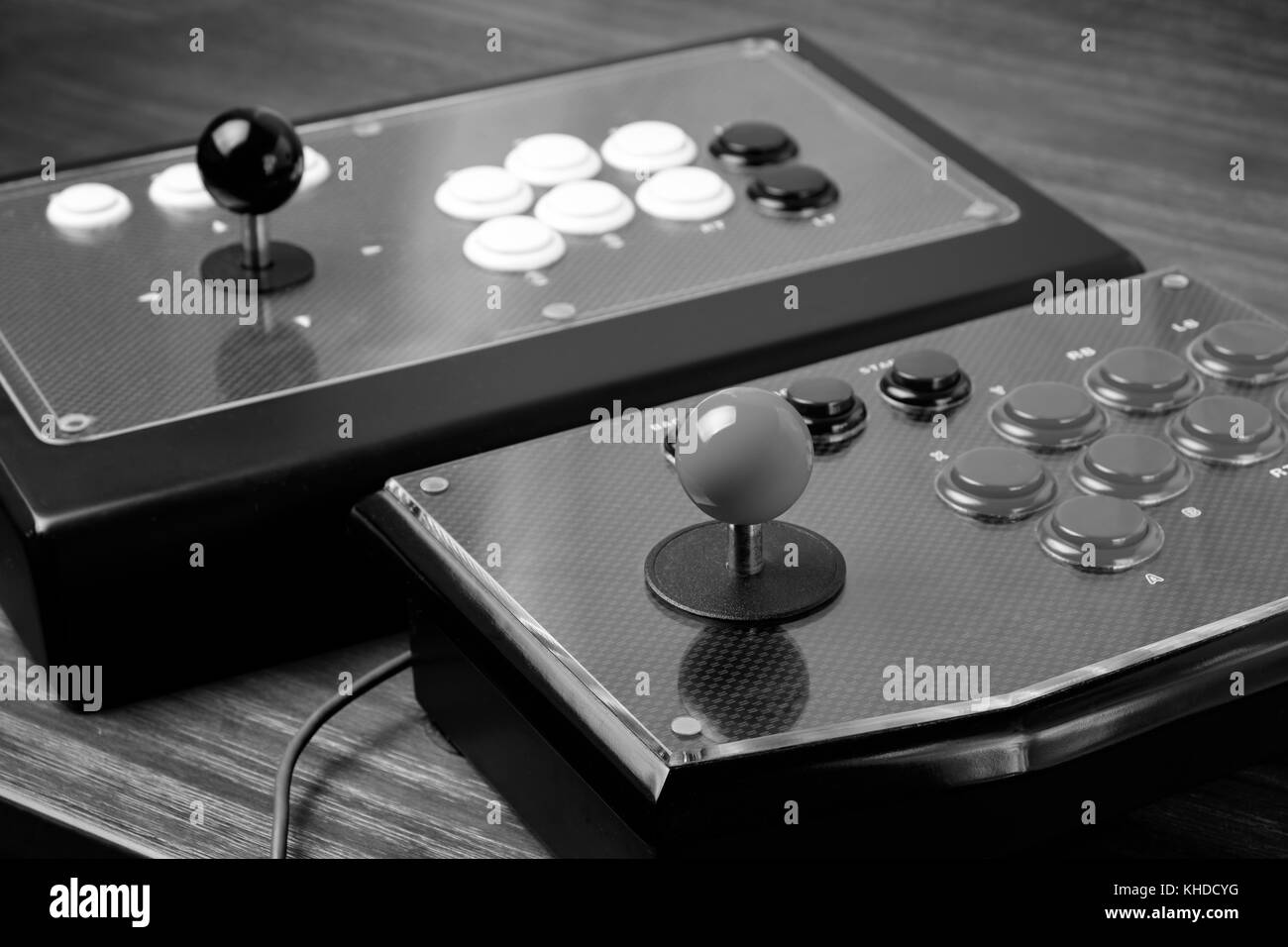 Real Arcade Joystick on Wood table (Black and white) - Stock Image