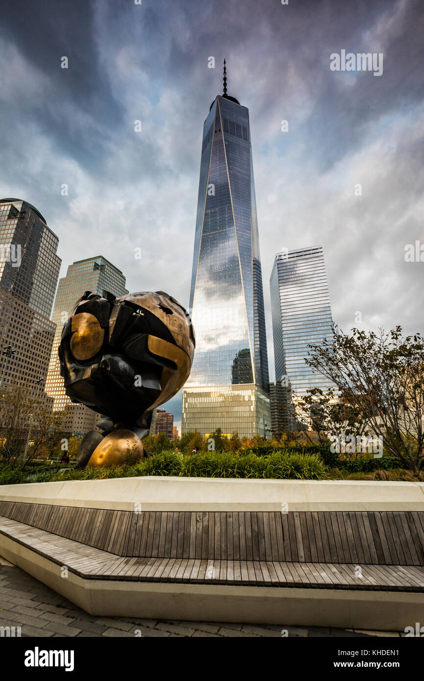 The Sphere in Liberty Park and Freedom tower on the back in New york City Stock Photo