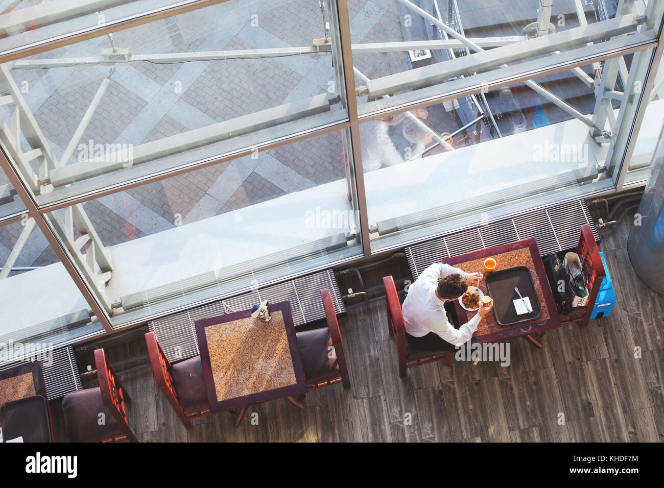 business lunch, top view of businessman eating in cafe, high angle of canteen for employees - Stock Image