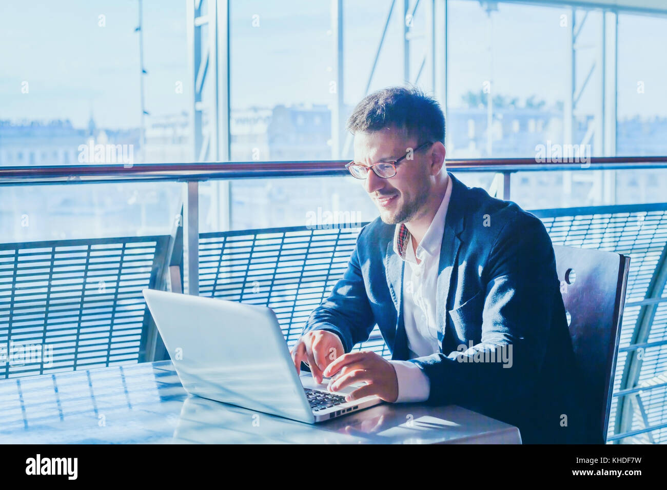 business man entrepreneur working on computer, businessman reading emails and smiling - Stock Image
