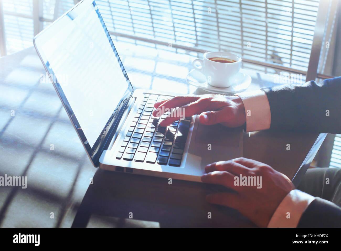 businessman working on computer, closeup of  hands, modern technology concept - Stock Image