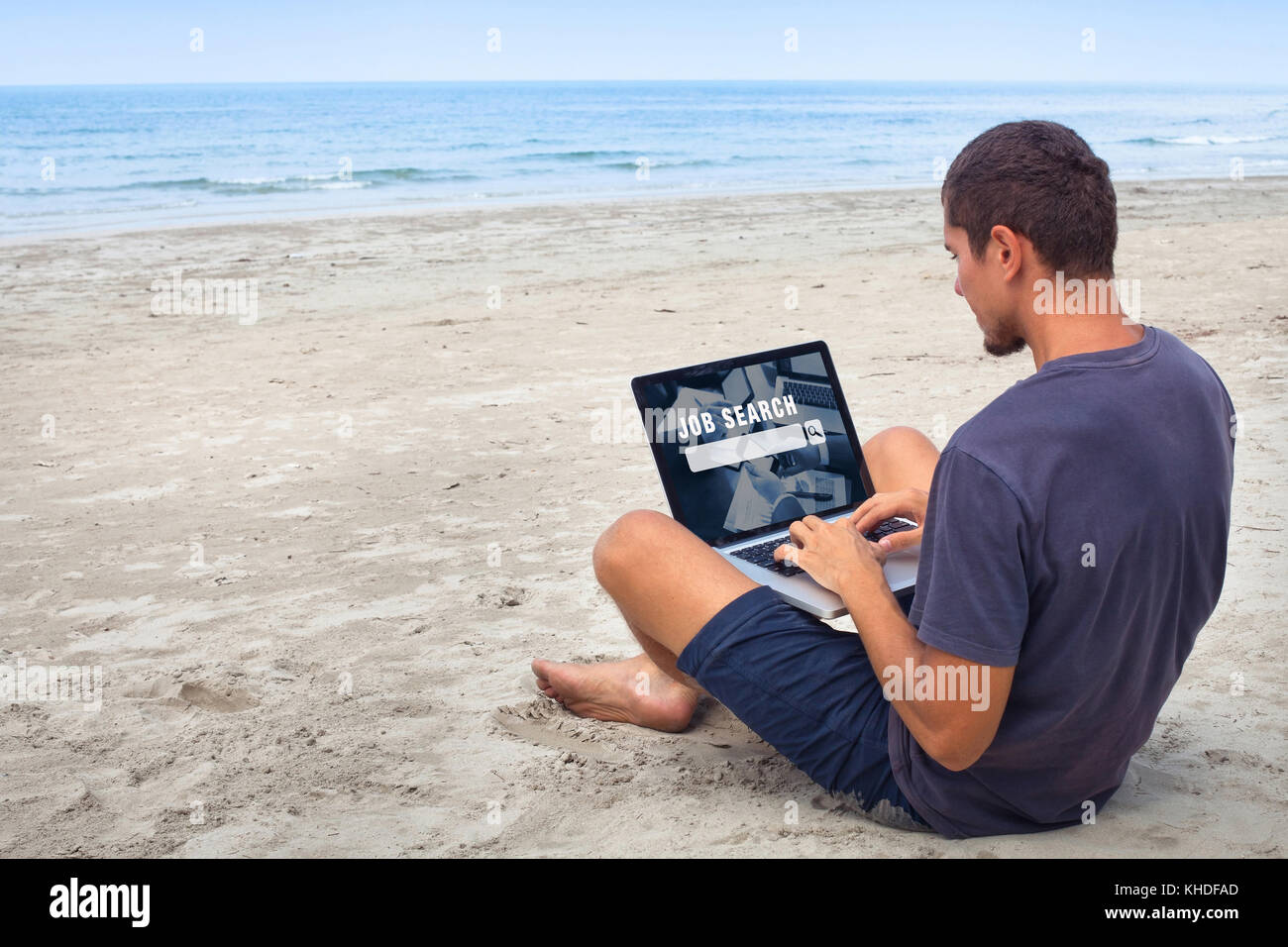 freelancer looking for work online, job search on internet, man sitting on the beach with laptop computer Stock Photo