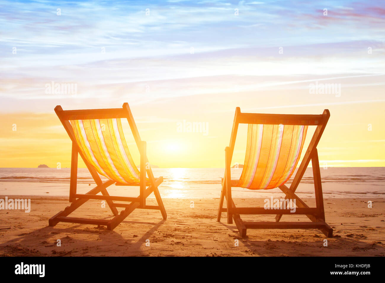 Beach Tourism Holiday Background With Couple Of Deck Chairs At Stock Photo Alamy
