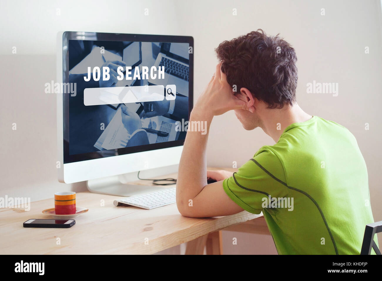 unemployment concept, job search on internet, man at home looking for good career - Stock Image