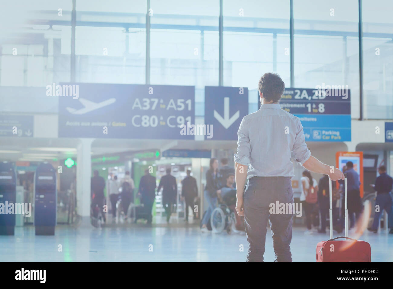 business travel, man passenger in airport waiting for the flight in modern terminal - Stock Image