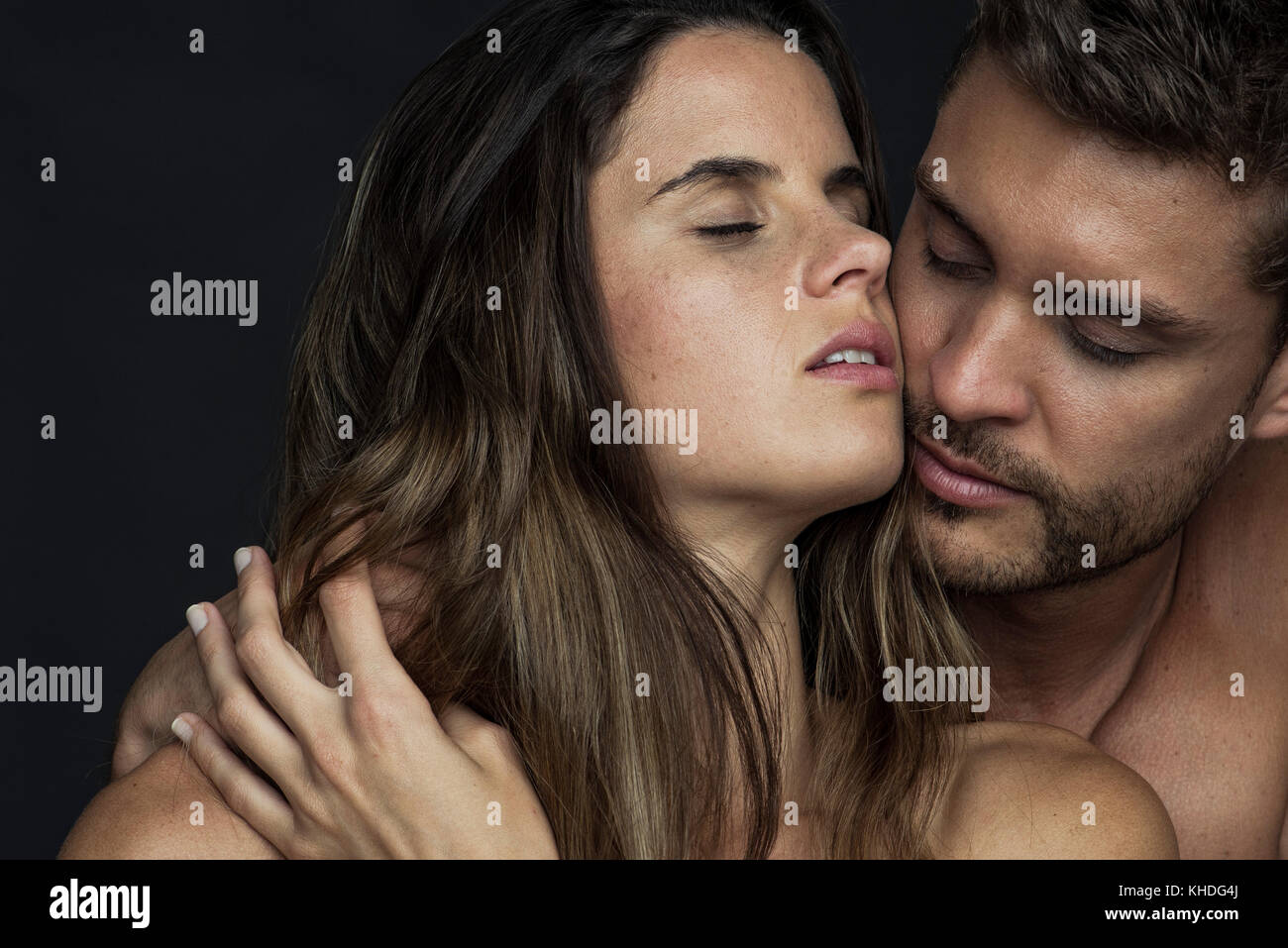 Passionate couple cheek to cheek with eyes closed Stock Photo